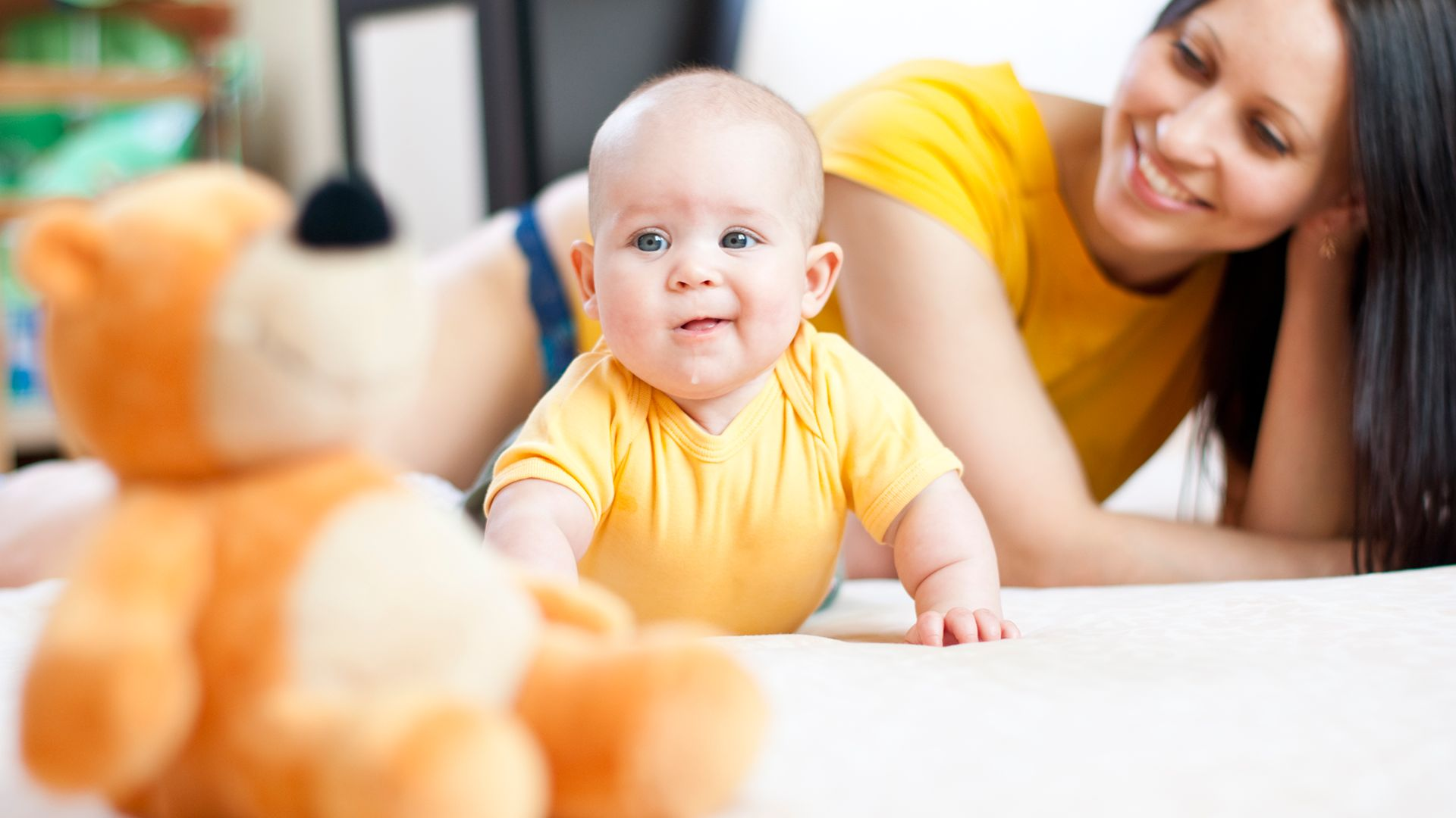 baby_with_toy_out_of_reach