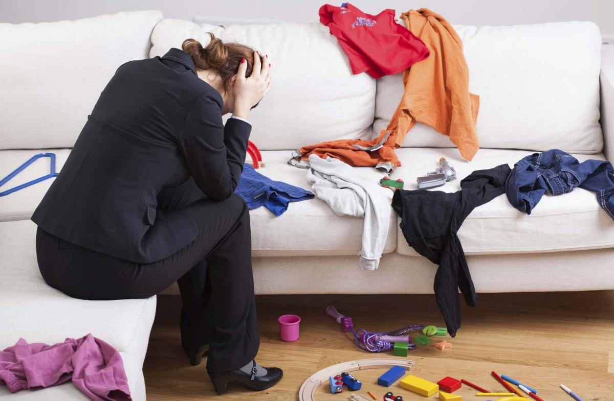 Adult-organize-Conquer_clutter-Article-656-woman_couch_messy-ts_476825025-3